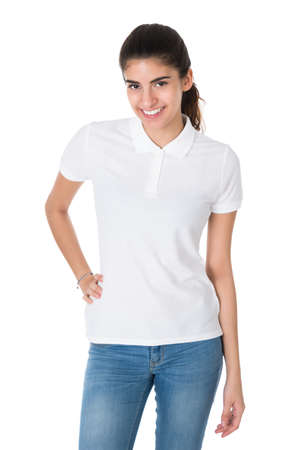 white woman: Portrait of beautiful young woman wearing blank tshirt on white background Stock Photo