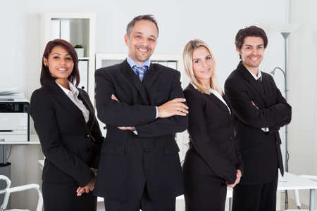Portrait of confident business team standing together in office photo