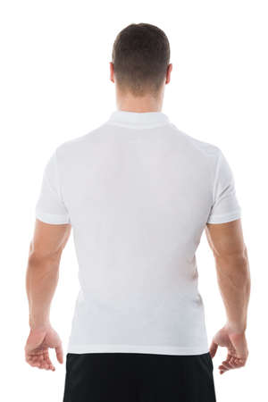 casuals: Rear view of man in casuals standing against white background