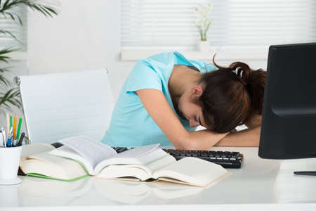 resting: Young female student resting table in home office Stock Photo
