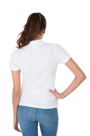 against white: Rear view of young woman wearing blank tshirt against white background