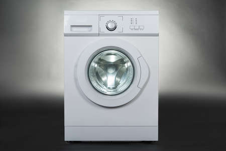 machines: White washing machine isolated over gray background
