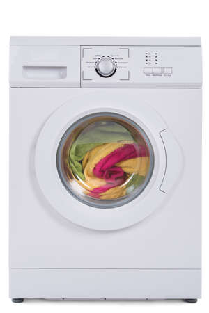 Washing machine full of dirty clothes isolated against blue background