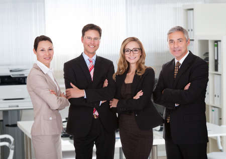 standing together: Portrait of confident business team standing together in office