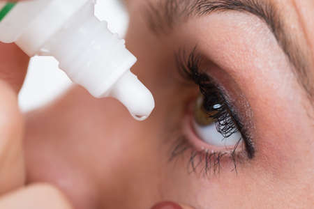 eyedropper: Close-up Of Person Pouring Drops In Eyes With Eyedropper