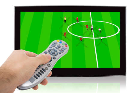 Hand using remote control of watch soccer match on flat screen television against white background photo