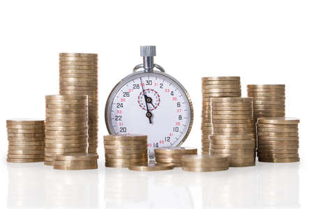 timekeeping: Stopwatch and coin stacks isolated over white background