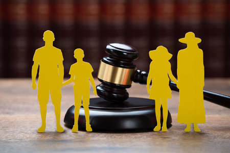 father in law: Closeup of paper family with mallet on table in courtroom Stock Photo