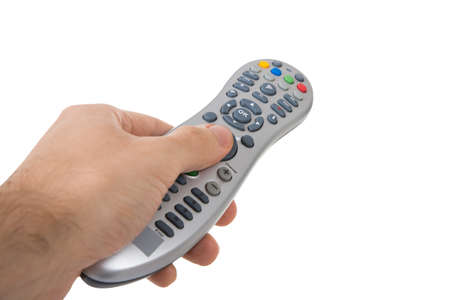 remote: Cropped hand holding remote control against white background