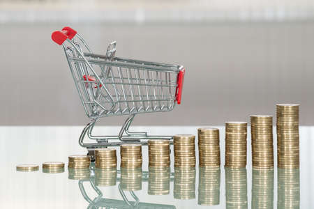 inflation basket: Close-up Of Shopping Cart And Stacked Cart On Desk Stock Photo