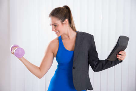 account executive: Young Happy Woman Doing Multiple Work. Multitasking Concept Stock Photo
