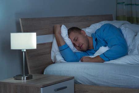 asleep: Young Man Sleeping On Bed In His Bedroom