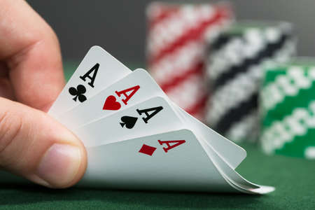 croupier: Close-up Of A Poker Player Playing Cards