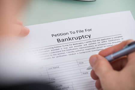 bank records: Close-up Photo Of Person Hand Filling Form