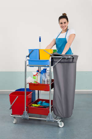 janitor: Happy Young Female Janitor With Cleaning Equipment