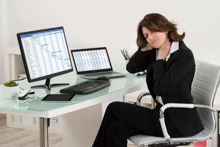 stress woman: Businesswoman Suffering From Neck Pain While Working In Office