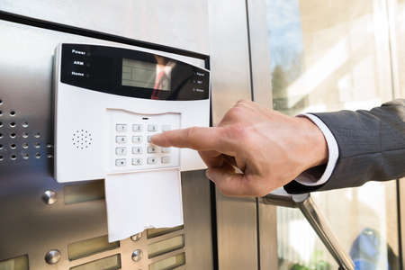 Close-up Of Businessperson Hand Entering Code In Security System Stockfoto