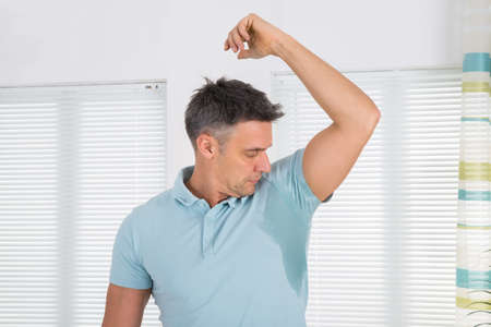 arm: Mature Man Notices His Sweat Under Armpit