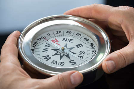 consulting business: Close-up Photo Of Person Hand Holding Compass