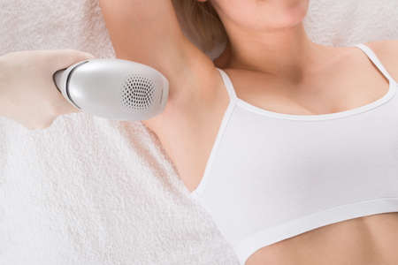 Close-up Of A Woman Receiving Laser Epilation Treatment On Under Arms At A Beauty Spa