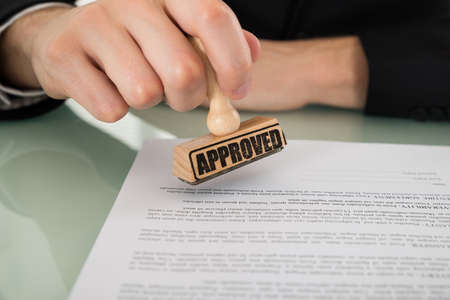 approving: Close-up Photo Of Businessman Hand Approving Document