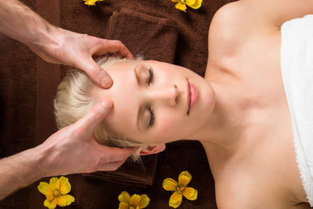 stress relief: Portrait Of A Young Woman Receiving Head Massage At A Beauty Salon