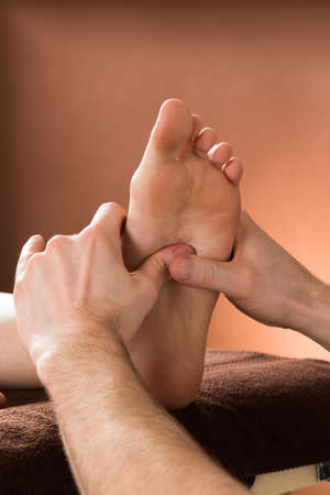 foot cream: Close-up Of A Woman Receiving Foot Massage From A Male Therapist At A Beauty Spa