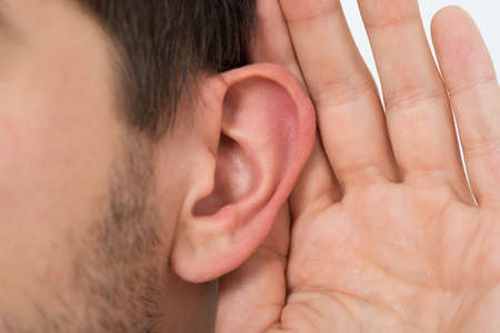 percept: Close-up Of Person Trying To Hear With Hand Over Ear