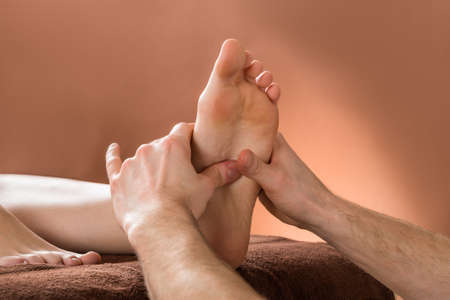 bare foot: Close-up Of A Woman Receiving Foot Massage From A Male Therapist At A Beauty Spa