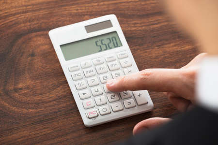 account executive: Close-up Of Businessman Hand Working On Calculator
