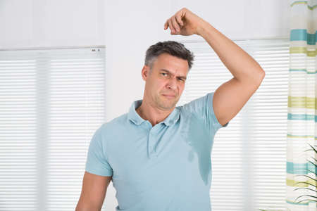 badly: Man With Hyperhidrosis Sweating Very Badly Under Armpit At Home