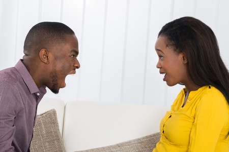 angry person: Angry Young African Man Screaming At Woman