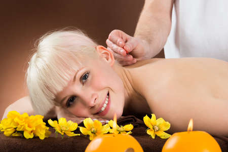 acupuncturist: Close-up Of A Young Woman Receiving Acupuncture Treatment In A Beauty Spa