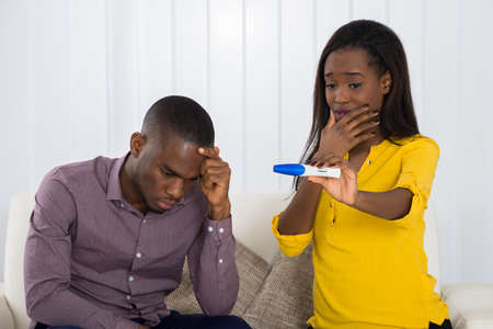 stress testing: Unhappy Young African Couple Looking At Pregnancy Test