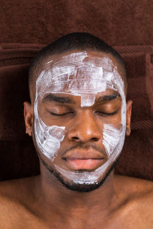 chemical peels: Close-up Of Face Mask Applied To Young Man In Spa