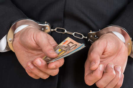 deceitful: Close-up Of Businessman In Handcuffs Arrested For Bribe