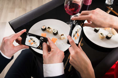 sushi: Close-up Of Photographing Food With Smartphones In A Restaurant