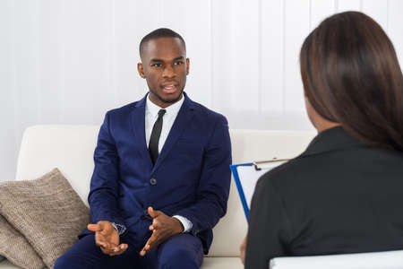 Young African American Man Explaining His Problems To The Psychologist Stock Photo