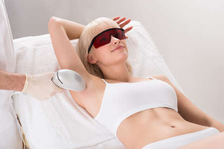 underarm: Young Woman Having Underarm Laser Hair Removal Treatment In Spa