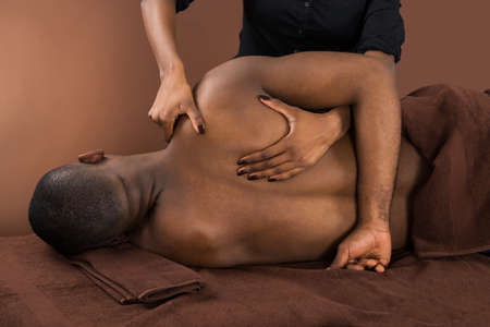 acupressure hands: Shirtless Young African Man Getting Spa Treatment
