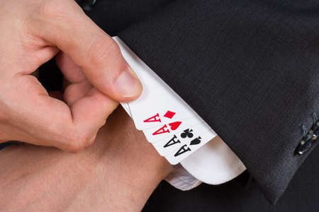 ace: Close-up Of Businessman Hand Removing Ace Cards From Sleeve