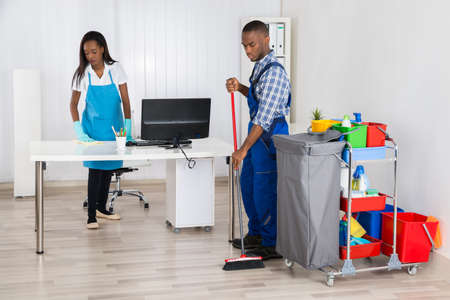 Photo Of Two Professional Janitors Cleaning Apartment Stock Photo ...