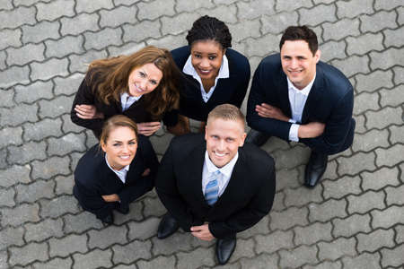 businesspeople: High Angle View Of Happy Businesspeople Standing Together