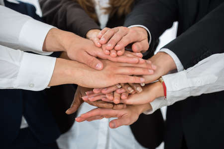 Close-up Of Businesspeople Hands Stacking Together Over Each Other Stock Photo