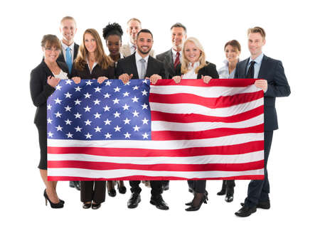 african student: Businesspeople Holding American Flag Against White Background Stock Photo