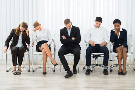 Businesspeople On A Chair Sleeping In A Waiting Room