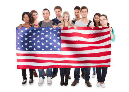 Happy People Holding American Flag Against White Background