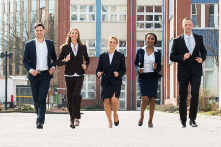 excited woman: Group Of Businesspeople Running Together In Race Competition