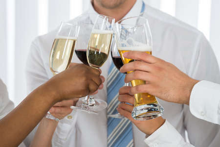 teamwork business: Close-up Of Businesspeople Hands Having Toast With Champagne Stock Photo