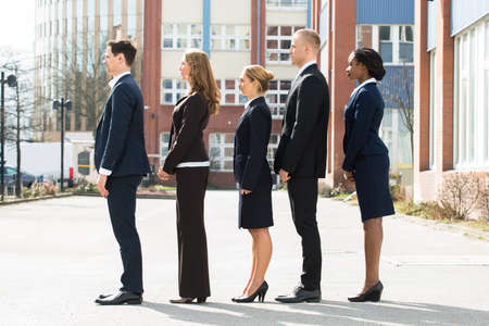 standing together: Group Of Multi-ethnic Businesspeople Standing In A Line;Outdoor